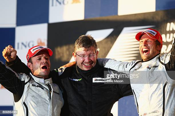 Race winner Jenson Button of Great Britain and Brawn GP celebrates with Team Principal Ross Brawn and second placed Rubens Barrichello of Brazil and...