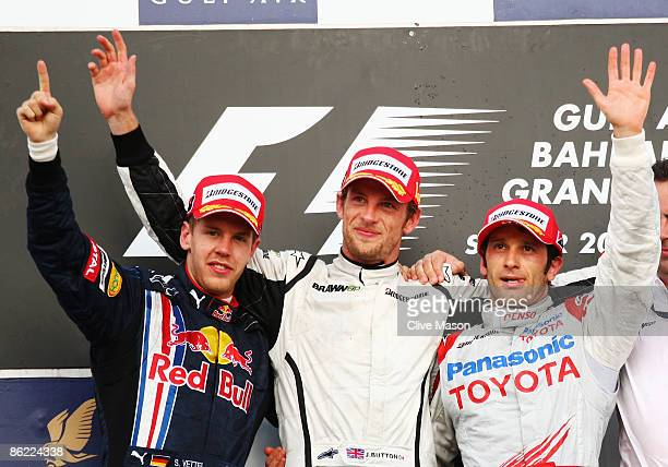 Race winner Jenson Button of Great Britain and Brawn GP, second placed Sebastian Vettel of Germany and Red Bull Racing and third placed Jarno Trulli...