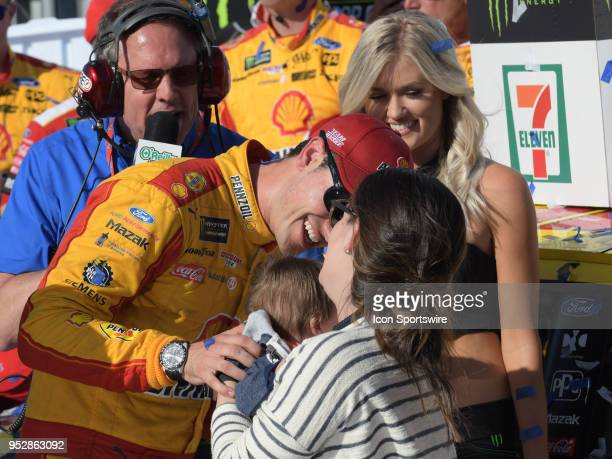 Race winner Joey Logano Team Penske Ford Fusion Shell Pennzoil is congratulated by his wife Brittany and son Hudson after winning the Monster Energy...