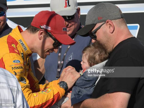 Race Winner Joey Logano Team Penske Ford Fusion Shell Pennzoil plays with his son in Victory Lane after winning the Monster Energy Cup Series 49th...