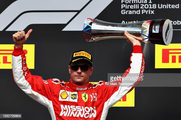 Race winner Kimi Raikkonen of Finland and Ferrari celebrates on the podium during the United States Formula One Grand Prix at Circuit of The Americas...