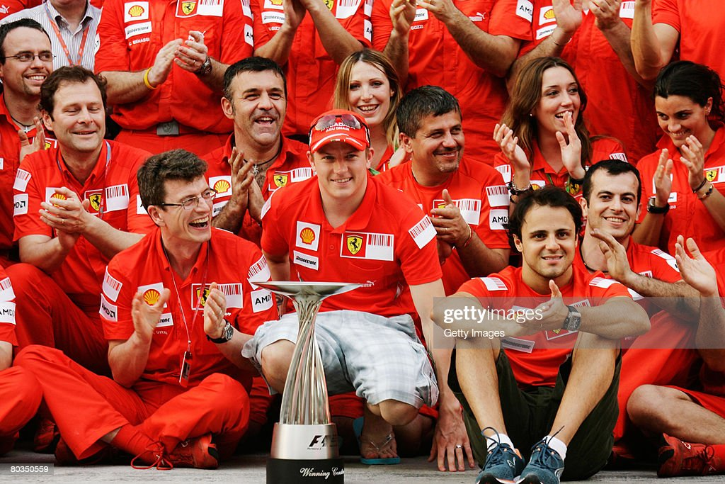 Race winner Kimi Raikkonen (C) of Finland and Ferrari celebrates with Ferrari team mates after winning the Malaysian Formula One Grand Prix at the Sepang Circuit on March 23, 2008 in Kuala Lumpur, Malaysia.