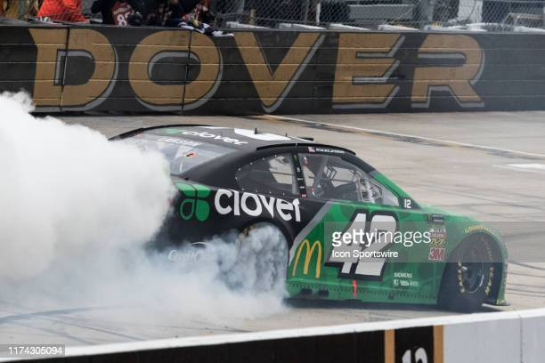 Race winner Kyle Larson celebrates with a burnout after winning the Drydene 400 Monster Energy NASCAR Cup Series Playoff Race on October 06 at Dover...