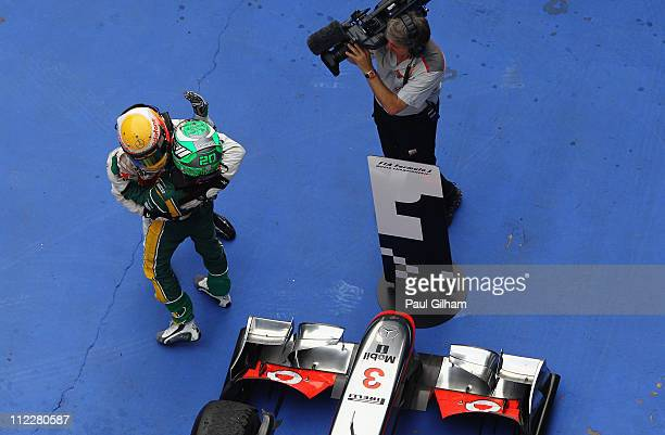 Race winner Lewis Hamilton of Great Britain and McLaren is congratulated by former team mate Heikki Kovalainen of Finland and Team Lotus in parc...