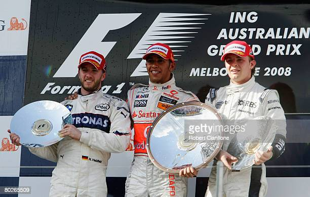 Race winner Lewis Hamilton of Great Britain and McLaren Mercedes celebrates with second placed Nick Heidfeld of Germany and BMW Sauber and third...