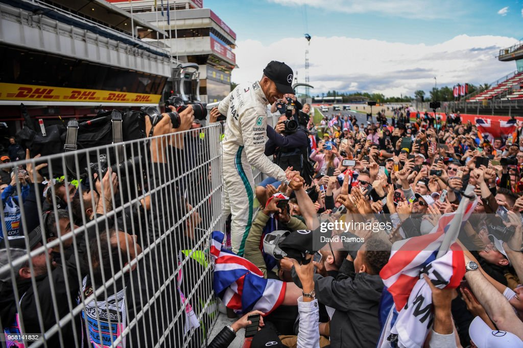 Race winner Lewis Hamilton of Great Britain and Mercedes AMG Petronas F1 Team Mercedes WO9 celebrates with the fans on the pit wall after the Spanish Formula One Grand Prix at Circuit de Catalunya on May 13, 2018 in Montmelo, Spain.