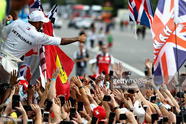 Race winner Lewis Hamilton of Great Britain and Mercedes GP celebrates after the Formula One Grand Prix of Italy at Autodromo di Monza on September 2...