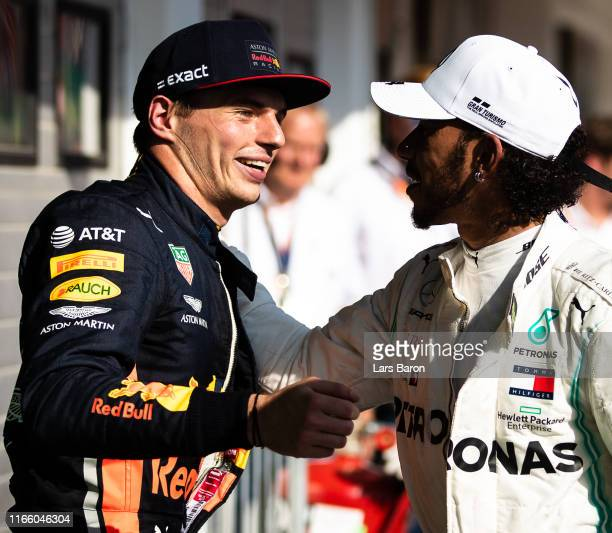 Race winner Lewis Hamilton of Great Britain and Mercedes GP and second placed Max Verstappen of Netherlands and Red Bull Racing celebrate in parc...