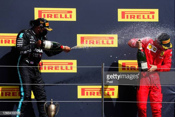 Race winner Lewis Hamilton of Great Britain and Mercedes GP and thirdplaced Charles Leclerc of Monaco and Ferrari celebrate on the podium during the...