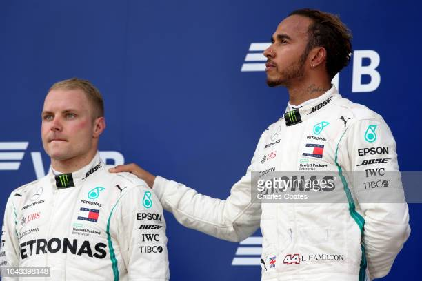 Race winner Lewis Hamilton of Great Britain and Mercedes GP and second placed Valtteri Bottas of Finland and Mercedes GP look on on the podium during...