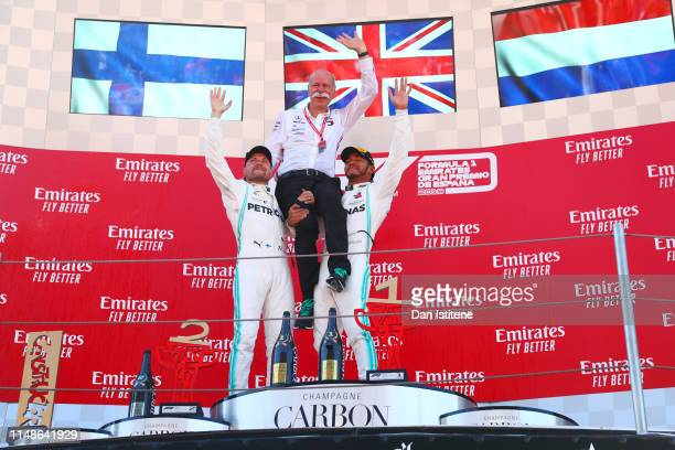 Race winner Lewis Hamilton of Great Britain and Mercedes GP and second place finisher Valtteri Bottas of Finland and Mercedes GP celebrate on the...