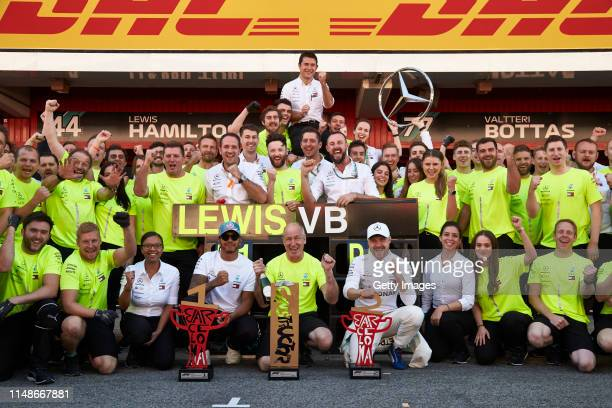 Race winner Lewis Hamilton of Great Britain and Mercedes GP and second place finisher Valtteri Bottas of Finland and Mercedes GP celebrate with their...