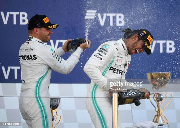 Race winner Lewis Hamilton of Great Britain and Mercedes GP and second placed Valtteri Bottas of Finland and Mercedes GP celebrate on the podium...