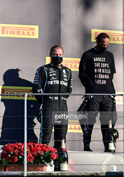Race winner Lewis Hamilton of Great Britain and Mercedes GP and second placed Valtteri Bottas of Finland and Mercedes GP stand on the podium during...
