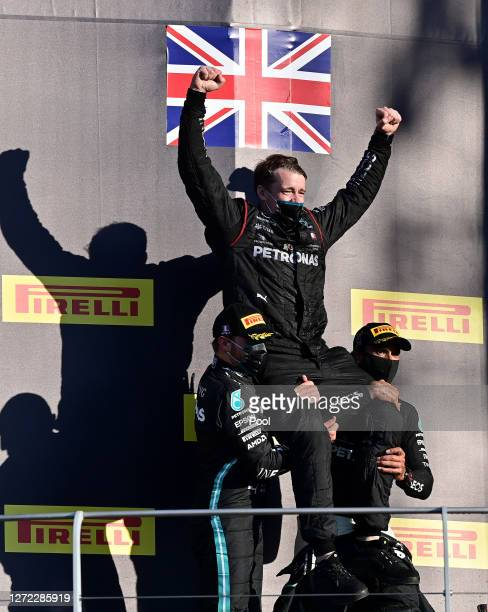 Race winner Lewis Hamilton of Great Britain and Mercedes GP and second placed Valtteri Bottas of Finland and Mercedes GP celebrate with a team member...