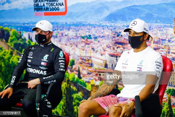 Race winner Lewis Hamilton of Great Britain and Mercedes GP and second placed Valtteri Bottas of Finland and Mercedes GP talk in a press conference...