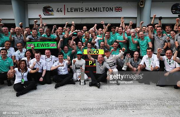 Race winner Lewis Hamilton of Great Britain and Mercedes GP and second placed Nico Rosberg of Germany and Mercedes GP celebrate with team mates and...