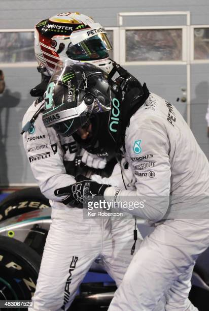 Race winner Lewis Hamilton of Great Britain and Mercedes GP and second placed team mate Nico Rosberg of Germany and Mercedes GP joke with one another...