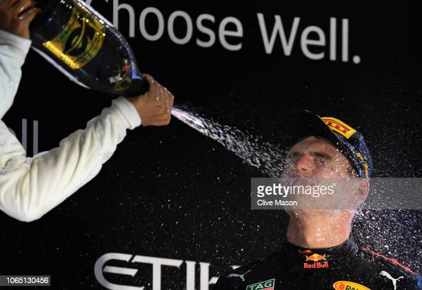 Race winner Lewis Hamilton of Great Britain and Mercedes GP and third placed Max Verstappen of Netherlands and Red Bull Racing celebrate on the...