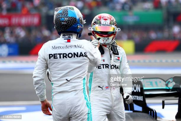 Race winner Lewis Hamilton of Great Britain and Mercedes GP and third placed Valtteri Bottas of Finland and Mercedes GP celebrate in parc ferme...