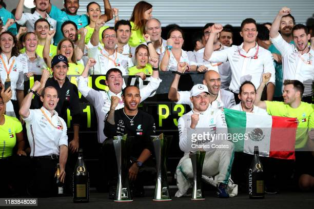 Race winner Lewis Hamilton of Great Britain and Mercedes GP and third placed Valtteri Bottas of Finland and Mercedes GP celebrate with their team...
