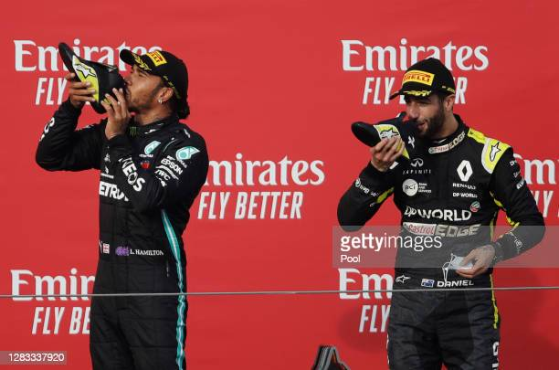 Race winner Lewis Hamilton of Great Britain and Mercedes GP and third placed Daniel Ricciardo of Australia and Renault Sport F1 celebrate on the...