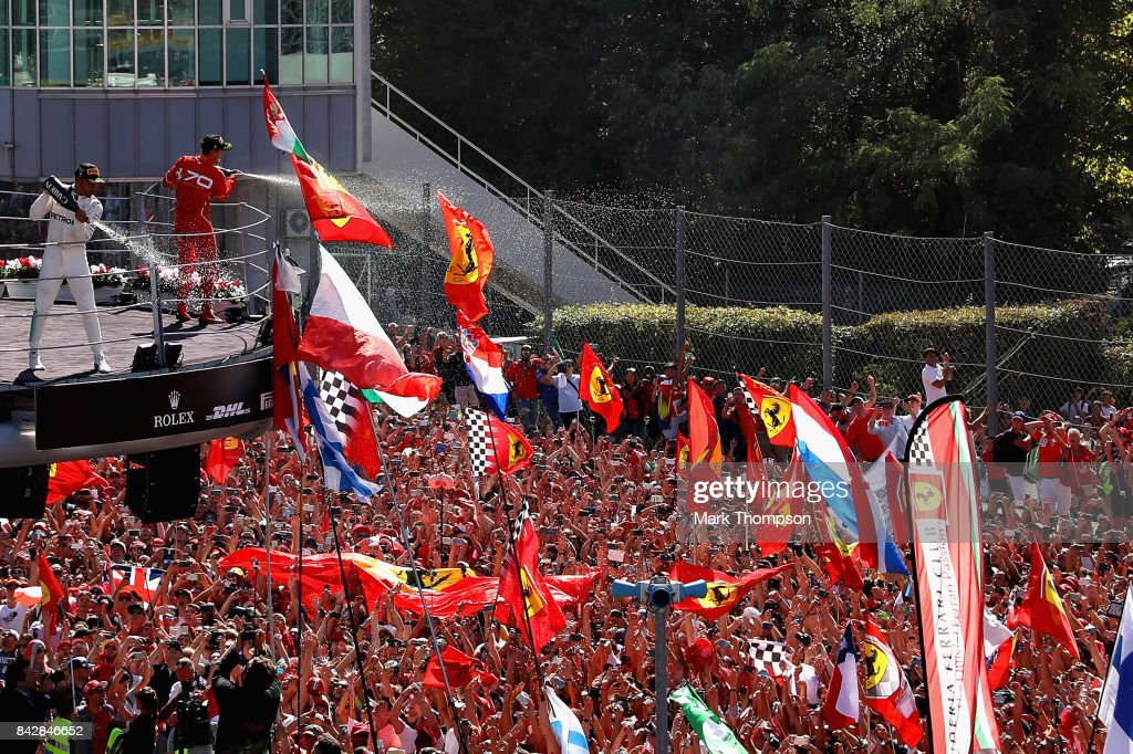 Race winner Lewis Hamilton of Great Britain and Mercedes GP and third place Sebastian Vettel of Germany and Ferrari celebrate on the podium after the Formula One Grand Prix of Italy at Autodromo di Monza on September 3, 2017 in Monza, Italy.
