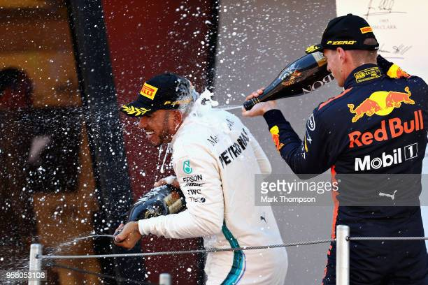 Race winner Lewis Hamilton of Great Britain and Mercedes GP and third place finisher Max Verstappen of Netherlands and Red Bull Racing celebrate on...