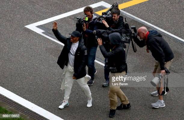 Race winner Lewis Hamilton of Great Britain and Mercedes GP greets the crowd during the Formula One Grand Prix of China at Shanghai International...
