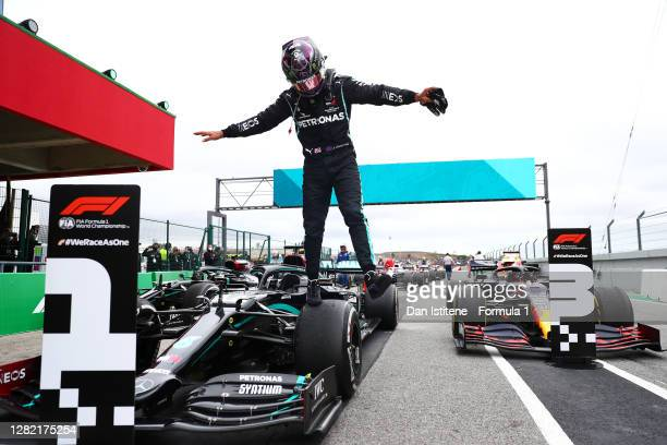 Race winner Lewis Hamilton of Great Britain and Mercedes GP celebrates his record breaking 92nd race win in parc ferme during the F1 Grand Prix of...