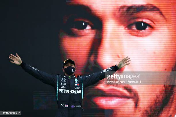 Race winner Lewis Hamilton of Great Britain and Mercedes GP celebrates his record breaking 92nd race win on the podium during the F1 Grand Prix of...