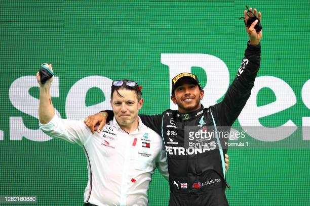 Race winner Lewis Hamilton of Great Britain and Mercedes GP celebrates his record breaking 92nd race win with race engineer Peter Bonnington on the...
