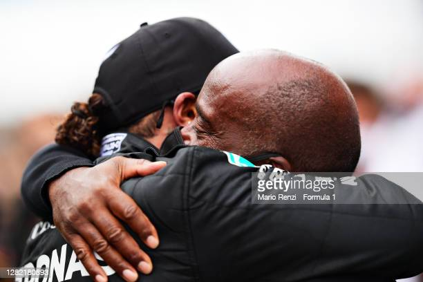Race winner Lewis Hamilton of Great Britain and Mercedes GP celebrates his record breaking 92nd race win with his father Anthony Hamilton in parc...