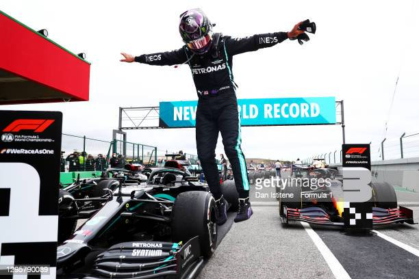 Race winner Lewis Hamilton of Great Britain and Mercedes GP celebrates his record breaking 92nd race win in parc ferme after the F1 Grand Prix of...