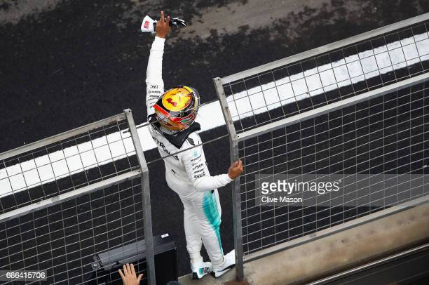 Race winner Lewis Hamilton of Great Britain and Mercedes GP celebrates his win in parc ferme during the Formula One Grand Prix of China at Shanghai...