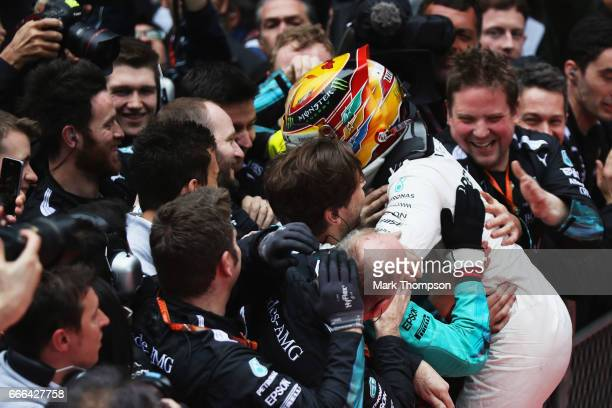 Race winner Lewis Hamilton of Great Britain and Mercedes GP celebrates his win with his team in parc ferme during the Formula One Grand Prix of China...