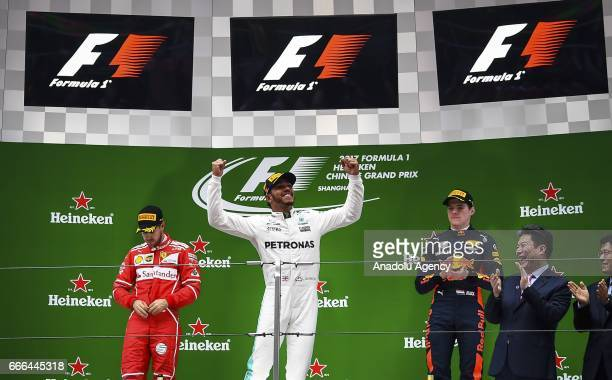 Race winner Lewis Hamilton of Great Britain and Mercedes GP celebrates his win on the podium after the Formula One Grand Prix of China at Shanghai...