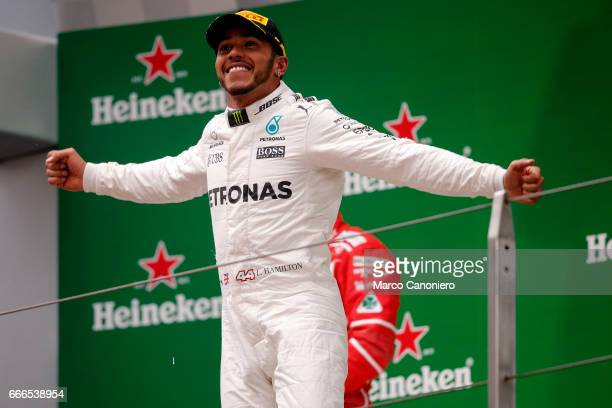 Race winner Lewis Hamilton of Great Britain and Mercedes GP celebrates his win on the podium during the Formula One Grand Prix of China