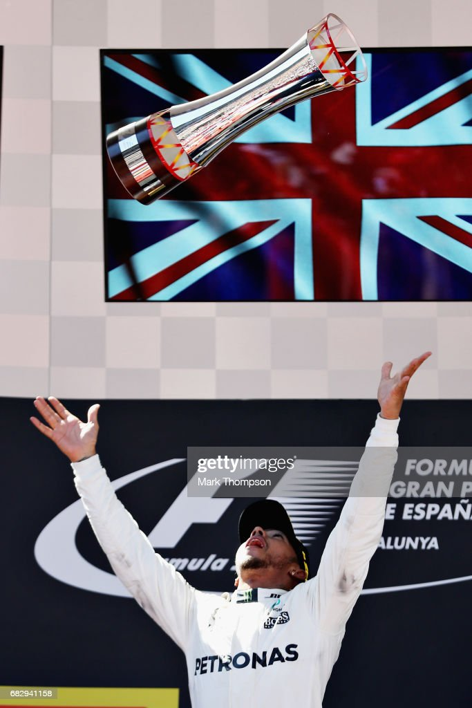Race winner Lewis Hamilton of Great Britain and Mercedes GP celebrates his win on the podium during the Spanish Formula One Grand Prix at Circuit de Catalunya on May 14, 2017 in Montmelo, Spain.