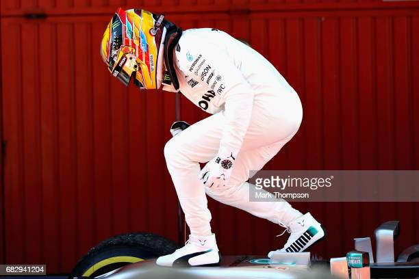 Race winner Lewis Hamilton of Great Britain and Mercedes GP celebrates his win in parc ferme during the Spanish Formula One Grand Prix at Circuit de...