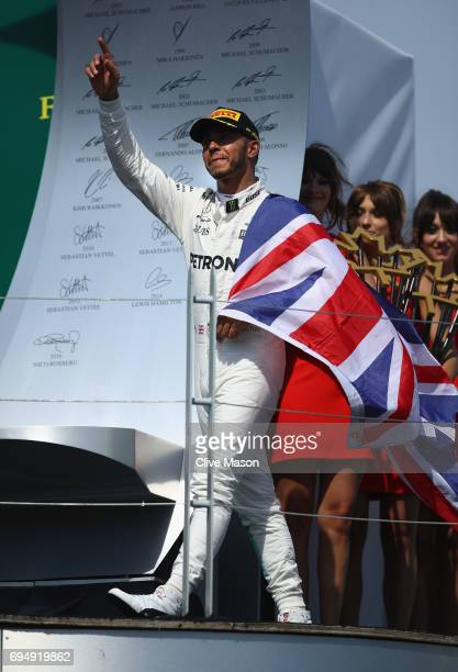 Race winner Lewis Hamilton of Great Britain and Mercedes GP celebrates his win on the podium during the Canadian Formula One Grand Prix at Circuit...