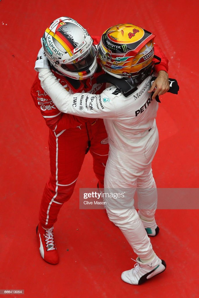 Race winner Lewis Hamilton of Great Britain and Mercedes GP hugs second placed finisher Sebastian Vettel of Germany and Ferrari in parc ferme during the Formula One Grand Prix of China at Shanghai International Circuit on April 9, 2017 in Shanghai, China.