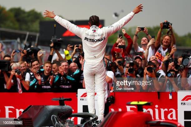 Race winner Lewis Hamilton of Great Britain and Mercedes GP celebrates in parc ferme during the Formula One Grand Prix of Germany at Hockenheimring...