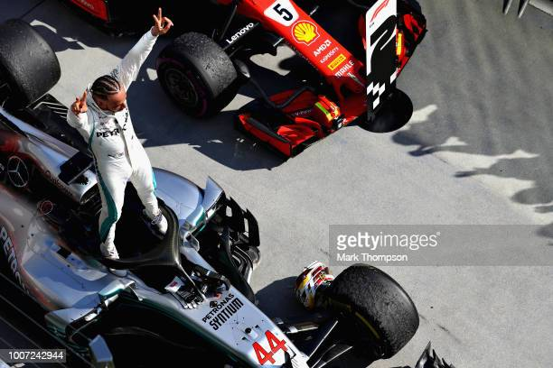 Race winner Lewis Hamilton of Great Britain and Mercedes GP celebrates in parc ferme during the Formula One Grand Prix of Hungary at Hungaroring on...