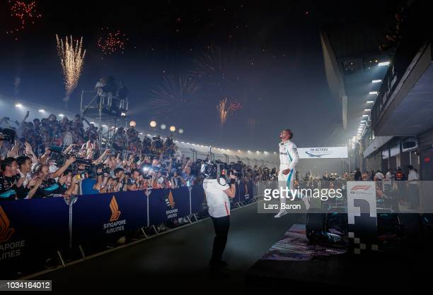Race winner Lewis Hamilton of Great Britain and Mercedes GP celebrates in parc ferme during the Formula One Grand Prix of Singapore at Marina Bay...