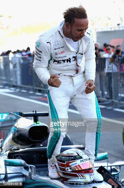 Race winner Lewis Hamilton of Great Britain and Mercedes GP celebrates in parc ferme during the Formula One Grand Prix of Japan at Suzuka Circuit on...