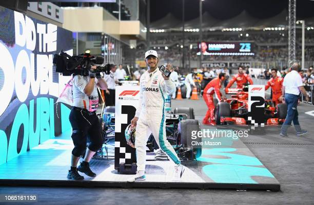 Race winner Lewis Hamilton of Great Britain and Mercedes GP celebrates in parc ferme during the Abu Dhabi Formula One Grand Prix at Yas Marina...