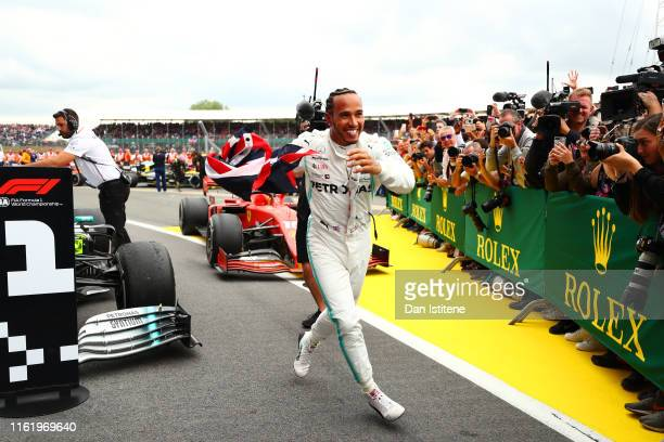Race winner Lewis Hamilton of Great Britain and Mercedes GP celebrates in parc ferme during the F1 Grand Prix of Great Britain at Silverstone on July...