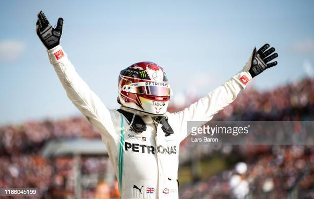 Race winner Lewis Hamilton of Great Britain and Mercedes GP celebrates in parc ferme during the F1 Grand Prix of Hungary at Hungaroring on August 04...