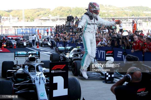 Race winner Lewis Hamilton of Great Britain and Mercedes GP celebrates in parc ferme during the F1 Grand Prix of Russia at Sochi Autodrom on...